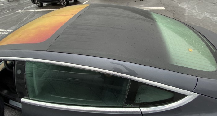 Tesla-Model-3-roof-appears-orange-in-wet-weather-by-Paul-Braren--TinkerTry