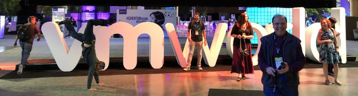 Attendee-doing-hand-stand-at-VMworld-2018-US-in-front-of-VMworld-sign-by-Paul-Braren-on-2018-08-28-at-TinkerTry.JPG