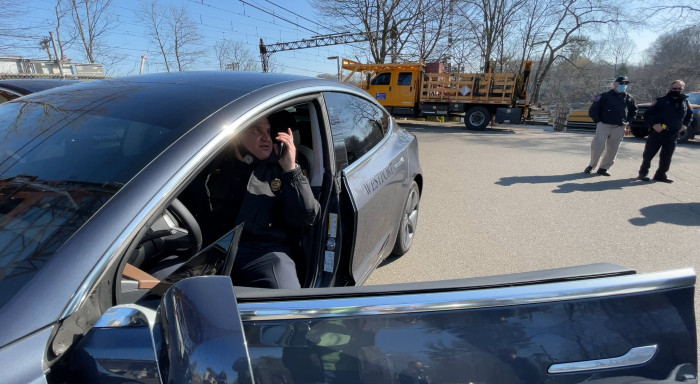 Westport-CT-Police-Chief-Foti-Koskinas-with-Tesla-Model-3-and-officers-by-Paul-Braren-at-TinkerTry-2021-03-22